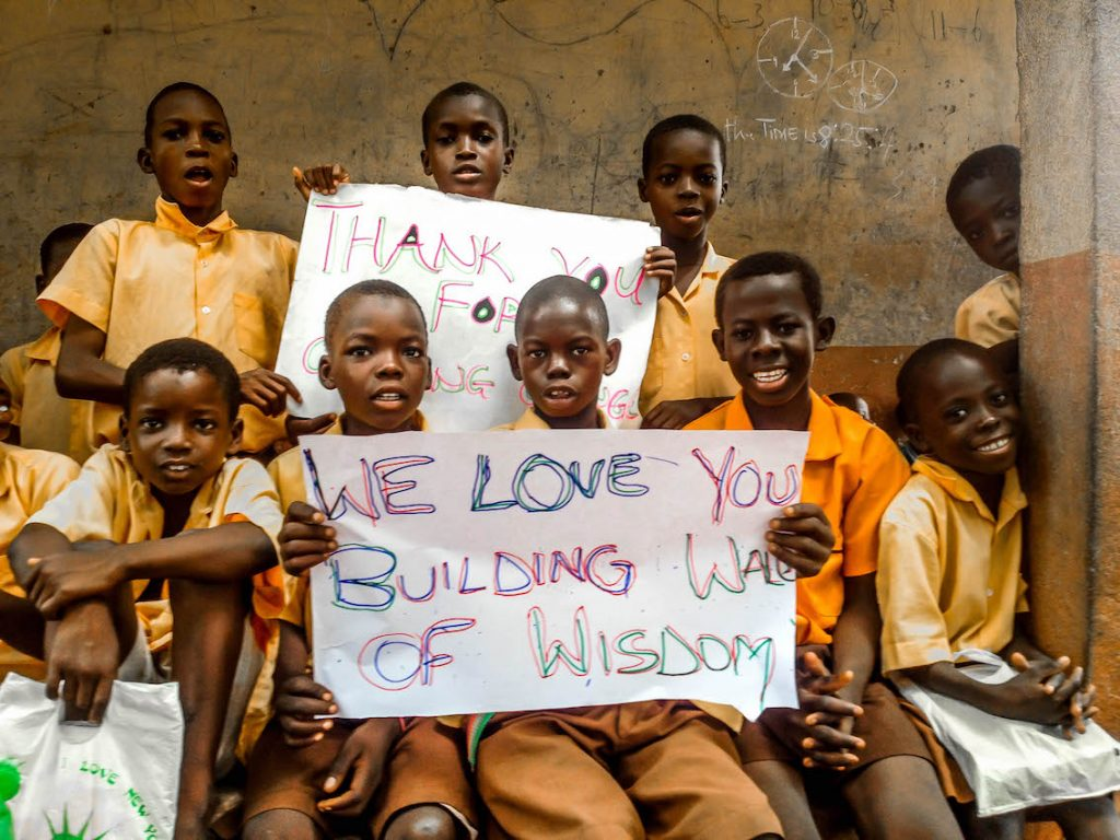 students-from-kpduuli-primary-showing-sign-post_